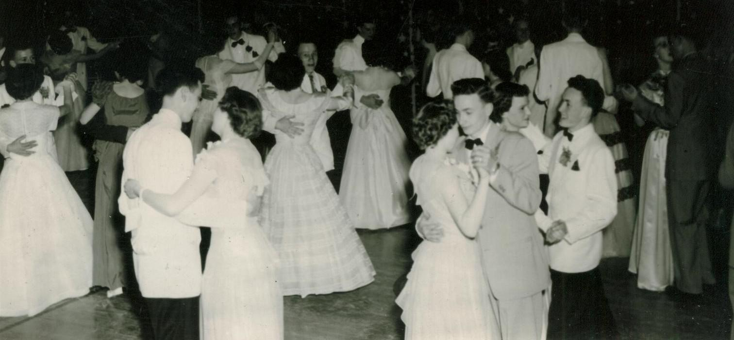 A black-and-white photo of people dancing